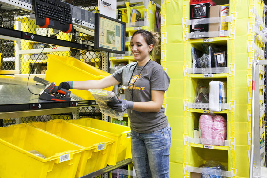 Amazon facilities associate picking in the FC