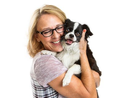 Happy Woman and Dog Together Over White