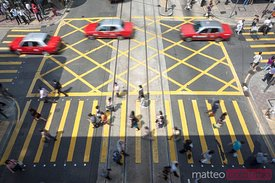 Zebra crossing with people rushing and taxis, Hong Kong