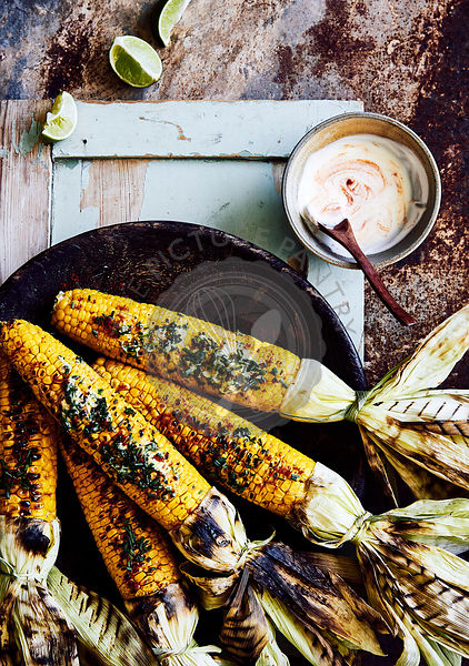 BBQ corn cobs with herb butter, sweet smoked paprika and yogurt source.