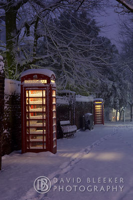 Telephone Boxes in London Snow