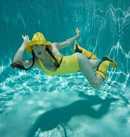Malena Sharkey in yellow foul weather outfit underwater; Lakeside pool