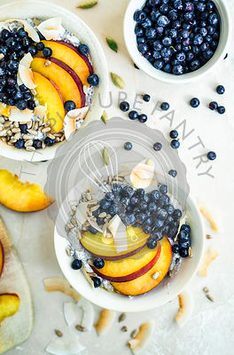 Chia pudding with nectarines, blueberries, and coconut flakes.