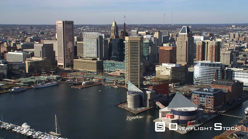 Aerial approach and flyover of downtown Baltimore from the harbor.