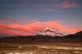 Fiery pink clouds above Sajama volcano at sunset, Sajama National Park, Bolivia