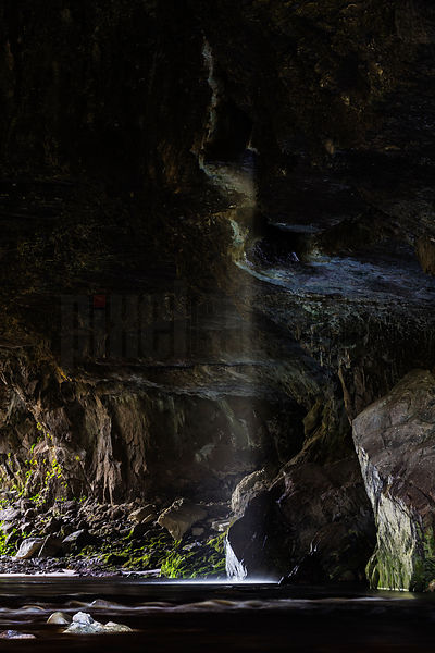 Waterfall Through Roof of Limestone cave