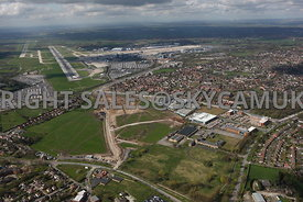 Manchester Airport view of Ringway Trading  Estate Shadowmoss Road Ferranti and Atlas Business Park Simonsway with Manchester Airport in background showing terminal buildings and runways