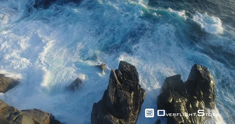 Huge waves crashing against a rocky shore in PerthAustralia