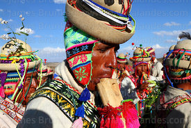 Musician playing a tarka, a type of wooden flute, Orinoca, Bolivia