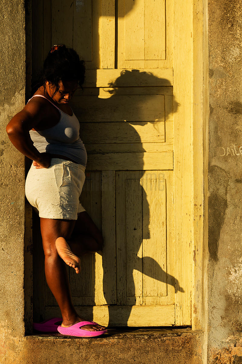 Woman Standing in her Front Doorway in the Early Morning Sun