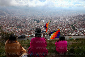 Aymara women in traditional dress looking at view over La Paz from El Alto, Bolivia