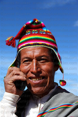 Man talking on mobile phone , Taquile Island , Peru