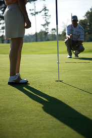 Golfer preparing to hit golf ball