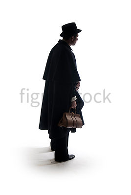 A Figurestock image of a Victorian man in a cloak, standing with bag and cane, from the side - shot from eye level.