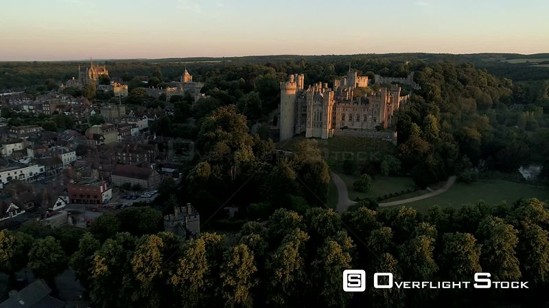 Drone descends slowly in front of Arundel Castle in the light of a misty summer dawn