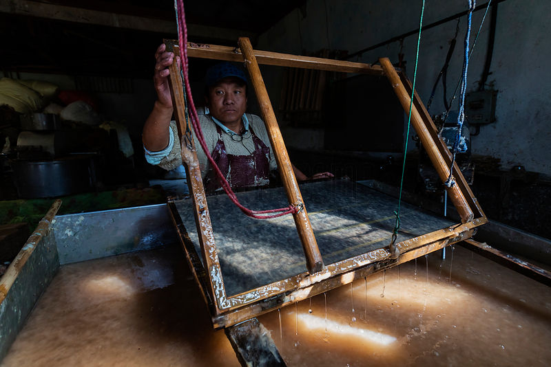 Worker Making Hand-Made Paper at the Jungshi Handmade Paper Factory
