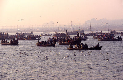 India - Allahbad - Pilgims on the water in boats going to the holy confluence of the Ganges and the Yamuna rivers. Ardh Kumbh Mela 1995, Allahbad, India