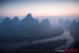 Sunrise over the karst peaks near Guilin