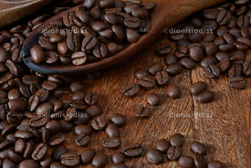 Spoon with Roasted Coffee Beans background.