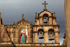 Espadaña / bell gable and statue of Santa Ana on top of facade of the Temple of the Holy Family / Templo de la Sagrada Familia, Cusco, Peru