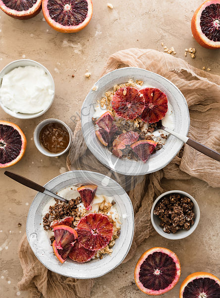 Blood Orange Yogurt Bowls topped with granola.