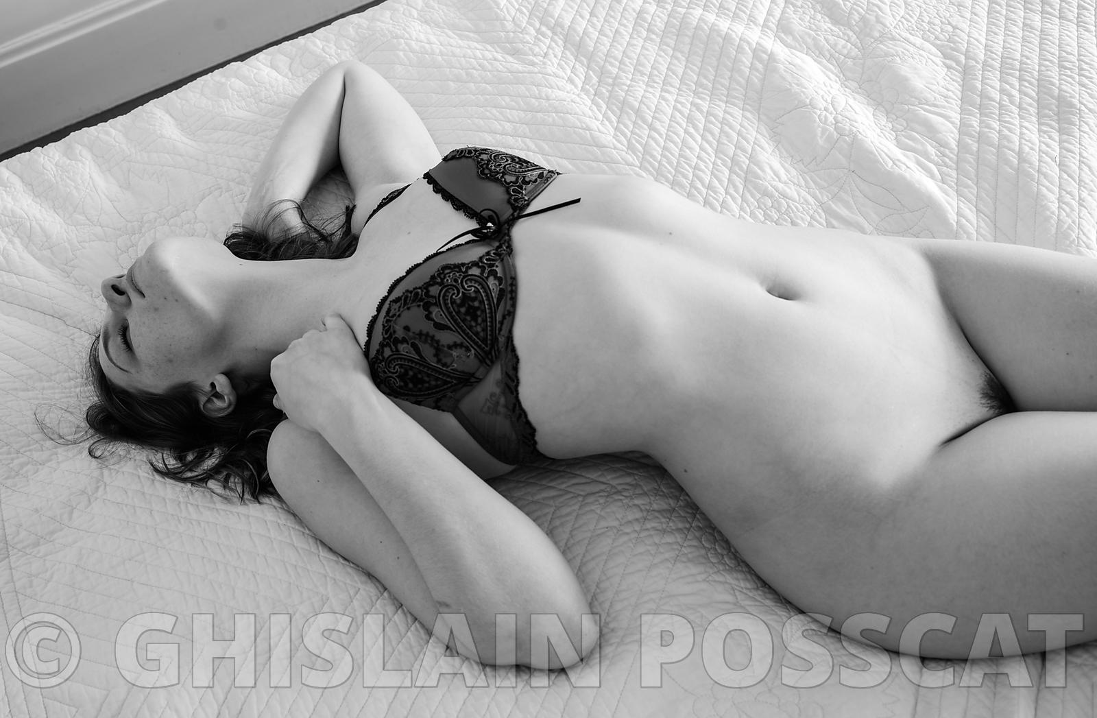 nude erotic woman on a bed