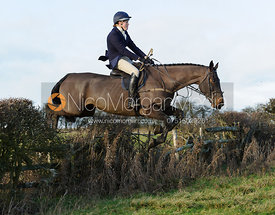 Sophie Miller jumping a hedge near Hill Top Farm