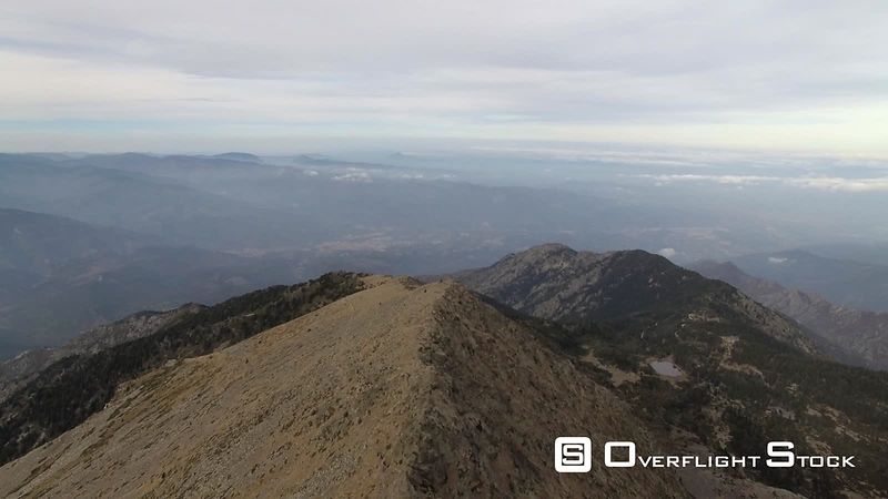 Aerial view of the Pic du Canigou in winter, Catalonian's Sacred Mountain, filmed by drone, Pyrenees-Orientales, France