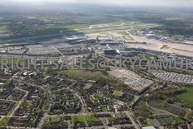 Manchester high level view of the Business Park developments and car parking and the undeveloped land North of Manchester Airport Wythenshaw