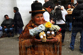 Aymara woman wearing traditional dress holding her skulls, Ñatitas festival, La Paz, Bolivia