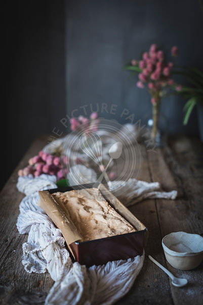 A sponge cake on a rustic kitchen table