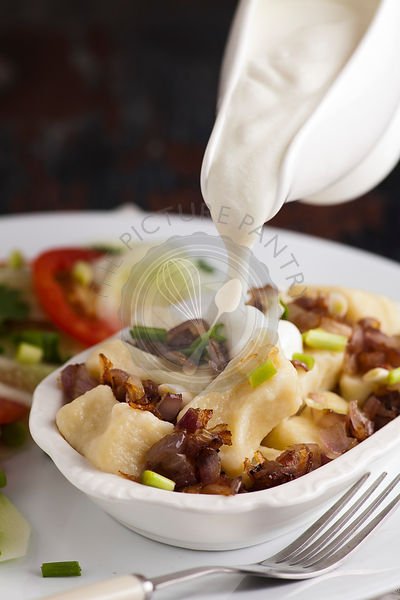 Gnocchi di patata, italian potato noodle, with salad and creme