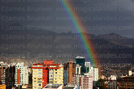 Rainbow over Sopocachi district and Muela del Diablo (a prominent rock outcrop overlooking the city) in rainy season, La Paz, Bolivia