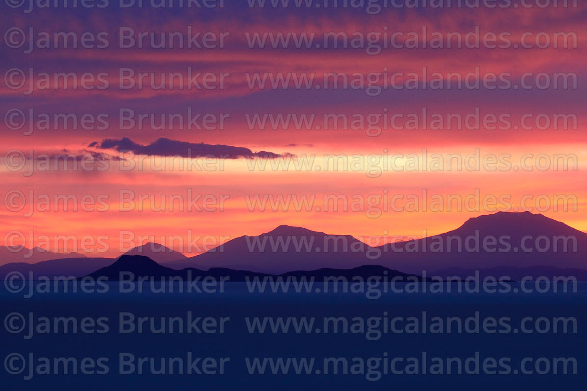 View of distant hills and volcanos at sunset from Incahuasi Island, Salar de Uyuni, Bolivia