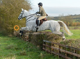 Katie Dutton jumping a hedge on Deane Bank