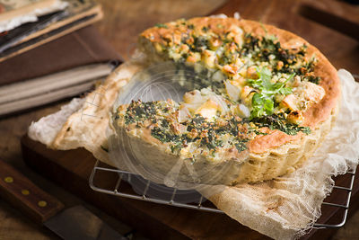 The recipe of potato and cheese pie with herbs and sour creme