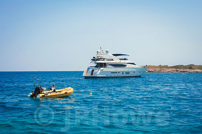 Motor Yacht with Yellow Dinghy Nearby