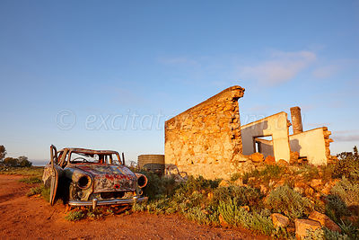 Car beside stone building, Silverton.