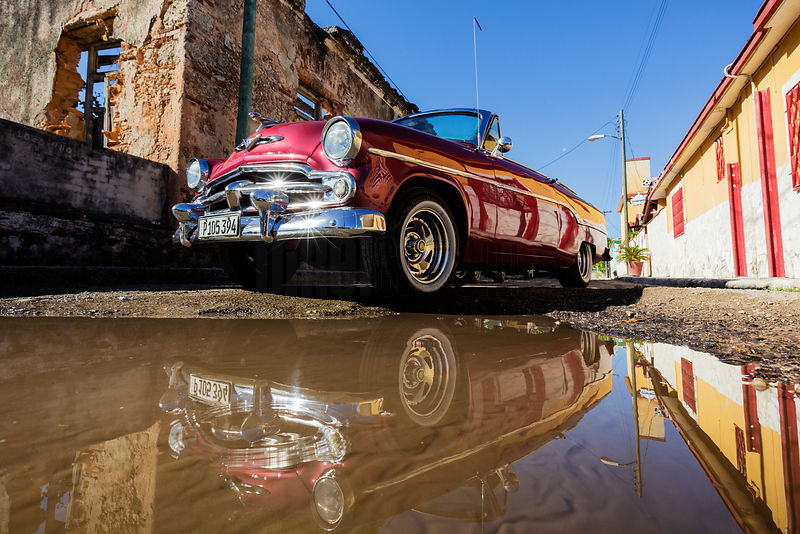 Reflection in a Puddle of a Vintage American Car