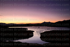 Lake in bofedales near Parinacota village at sunset, Lauca National Park, Region XV, Chile