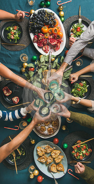 Company of friends or family celebrating Christmas together, vertical composition