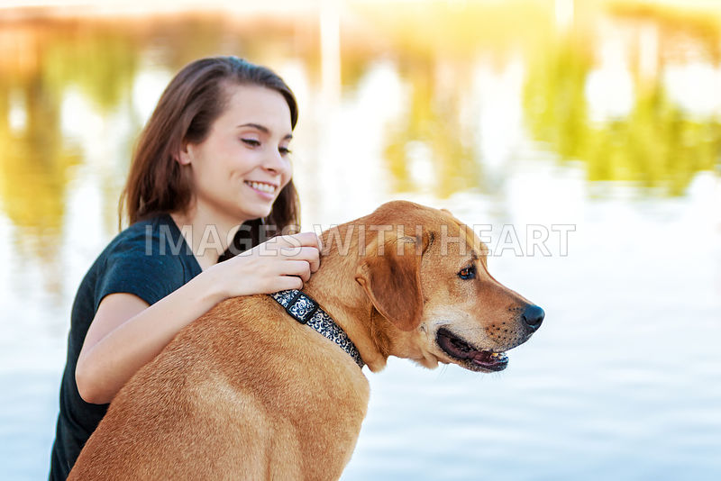 Girl and Dog Looking Over Lake