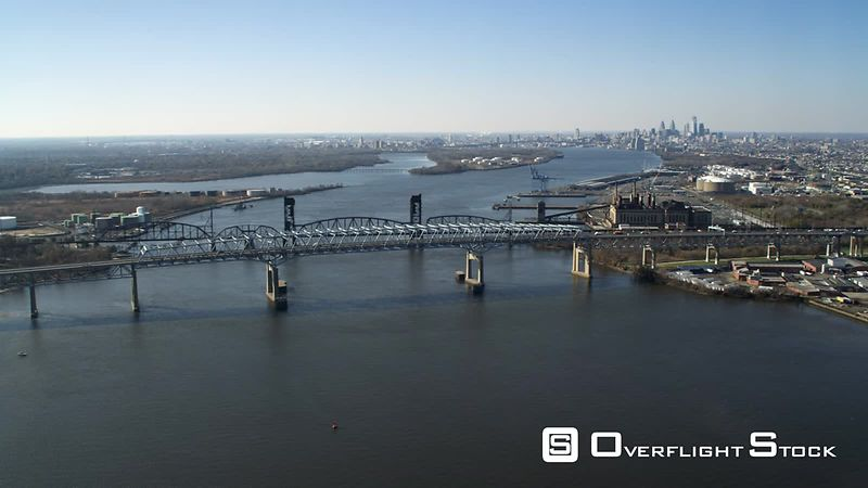 Aerial view of the Delaware River at the Betsy Ross Bridge with Philadelphia in the distance.
