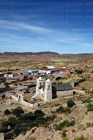 High angle view of Santa Barbara church and Curahuara de Carangas village, Oruro Department, Bolivia