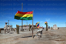 Bolivian flag, salt sculptures and souvenir stall outside house, Colchani, near Uyuni, Bolivia
