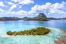 Aerial view of Motu Tapu and Bora Bora island, French Polynesia
