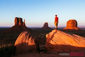 Man enjoying sunset over Monument Valley, USA