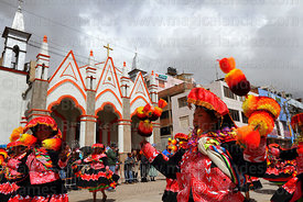 Wapululos dancers from Lampa village in front of Sanctuary of Virgen de la Candelaria, Puno, Peru