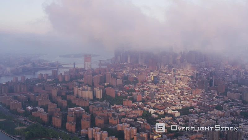 New York City Aerial view of low clouds over Manhattan and East River.  Shot with Cineflex and RED EpicW Helium.