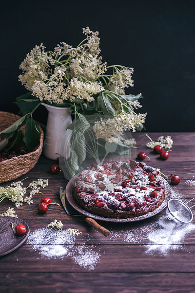 Cherry chocolate cake on a serving plate
